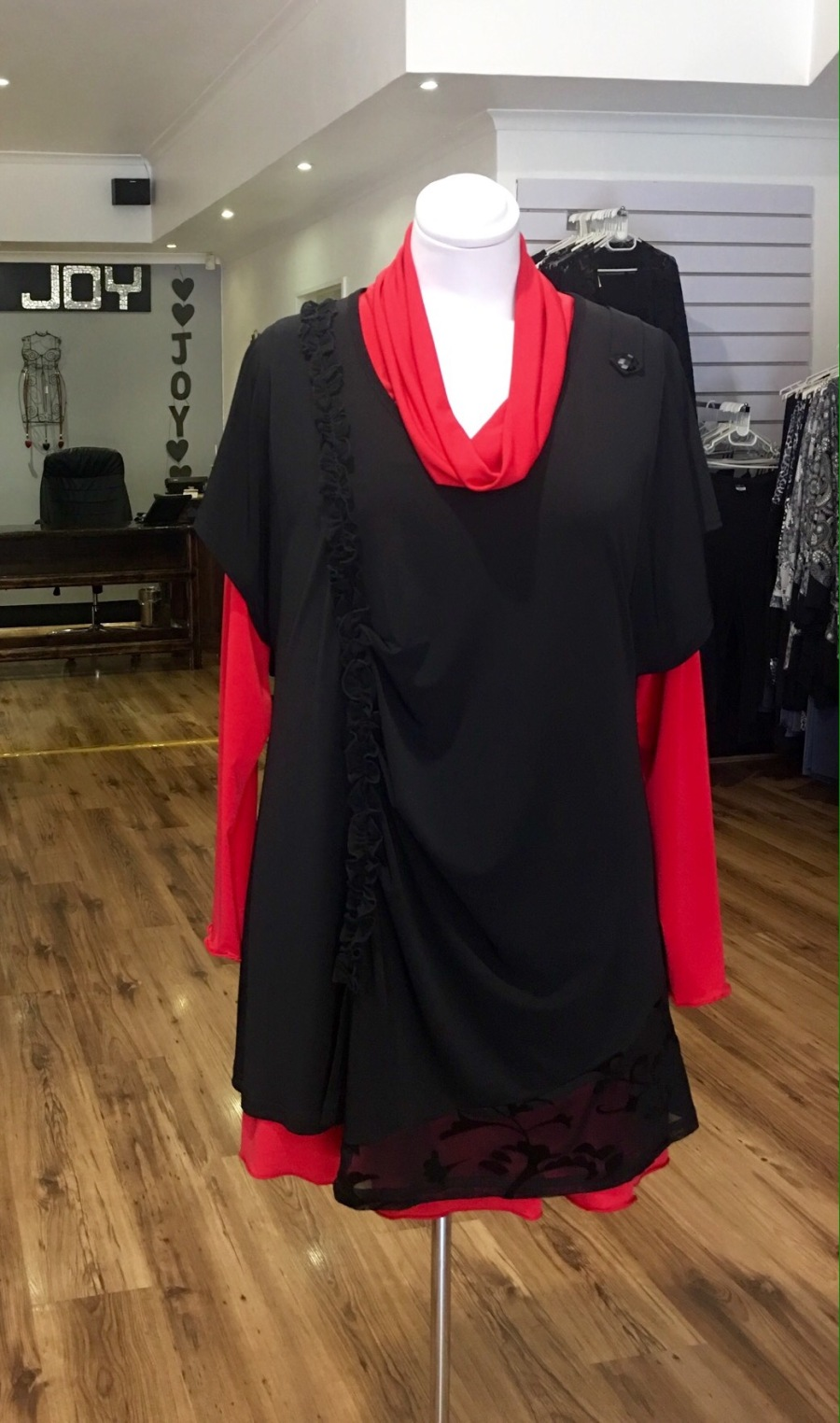 Black overvest with red cowl undertop